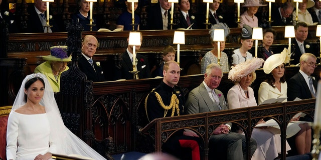 Behind Meghan Markle and Prince Harry is an empty chair which was reportedly left open for Princess Diana during the ceremony.
