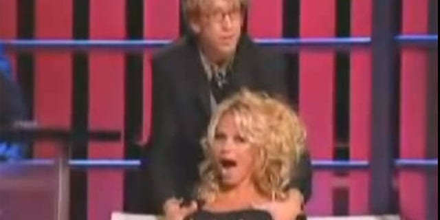 Pamela Anderson appeared stunned when Andy Dick grabbed her breasts during her Comedy Central Roast in 2005.