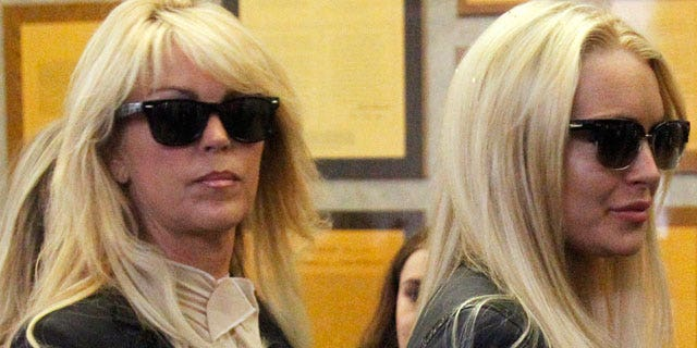 July 20: Actress Lindsay Lohan stands with her mother Dina Lohan.