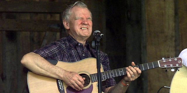 In this April 28, 2001 file photo, Music legend Doc Watson performs at the annual Merlefest at Wilkes Comunity College in Wilkesboro, N.C
