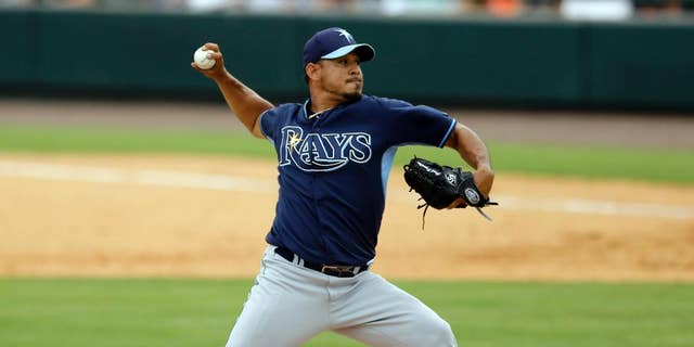 FILE - In this March 28, 2014, file photo, Tampa Bay Rays relief pitcher Joel Peralta throws during the sixth inning of an exhibition spring training baseball game against the Detroit Tigers in Lakeland, Fla. Peralta has been acquired by the Los Angeles Dodgers from the Bay Rays as part of a four-player trade announced Thursday, Nov. 20, 2014.  (AP Photo/Carlos Osorio, File)