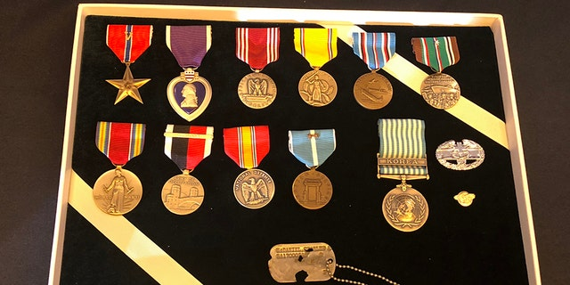 Master Sgt. Charles Hobert McDaniel's dog tag and other medals to presented to his two sons.