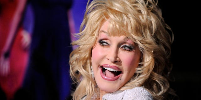 """Actress and singer Dolly Parton arrives at the Hollywood premiere of """"Joyful Noise"""" in Los Angeles, California January 9, 2012. REUTERS/Gus Ruelas (UNITED STATES - Tags: ENTERTAINMENT HEADSHOT PROFILE) - RTR2W377"""
