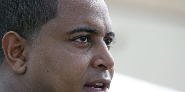 FILE - In this July 22, 2013, file photo, Miami Dolphins tackle Jonathan Martin in interviewed after an NFL football practice in Davie, Fla. (AP)