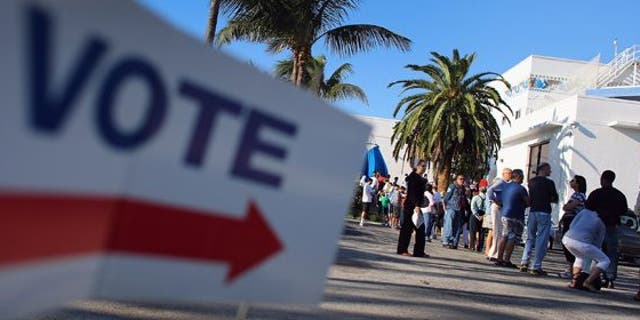 MIAMI, FL - OCTOBER 27:  Early voters wait in line to vote in the presidential election on the first day of early voting at a polling station setup at the City of Miami City Hall on October 27, 2012 in Miami, Florida. Early voting in one of the important swing states is held for eight straight 12-hour days, leading up to the November 6 general election.  (Photo by Joe Raedle/Getty Images)