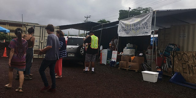 Residents gather to help and sort much-needed supplies at the Hawaii Island Donation Drive.