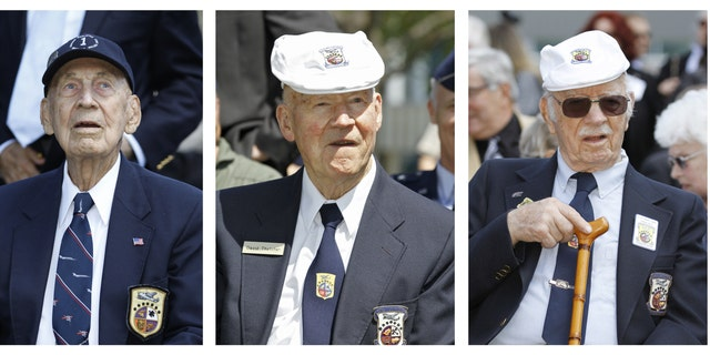 In these April 18, 2012 file photos, surviving Doolittle Raiders Richard Cole, left, David Thatcher, center, and Edward Saylor take part in a commemoration for the 70th anniversary of the raid on Tokyo at the Museum of the United States Air Force in Dayton, Ohio.