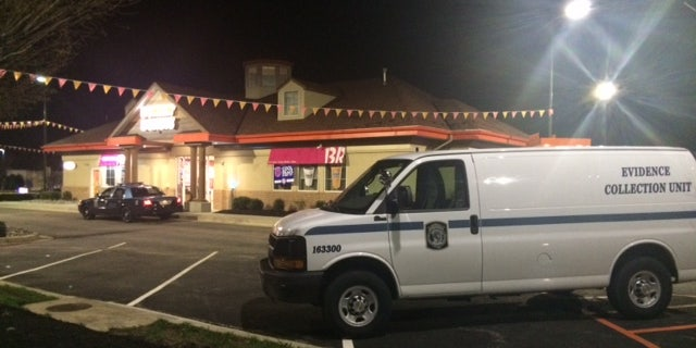 April 12, 2015: Police respond to the scene of a homicide in a Dunkin' Donuts in Hanover, Md.