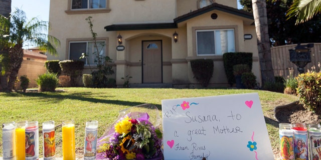 Oct. 25, 2012: Tributes are seen outside the home of a family targeted by a gunman in Downey, Calif.