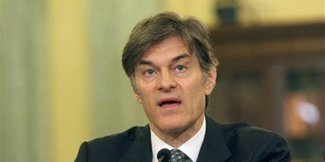 Dr. Mehmet Oz testifies on Capitol Hill in Washington, June 17, 2014, before the Senate subcommittee on Consumer Protection, Product Safety, and Insurance.