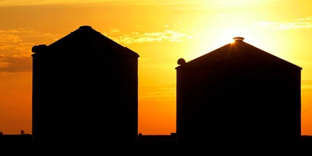 July 22, 2012: The sun rises over grain silos in Ashland, Ill.