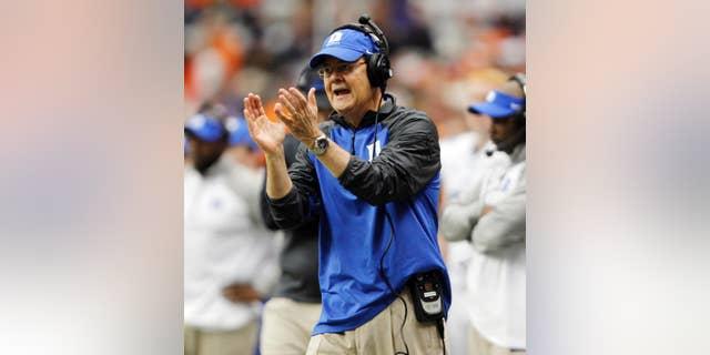 Duke's head coach David Cutcliffe calls out to his player in the second quarter of an NCAA college football game against Syracuse in Syracuse, N.Y., Saturday, Nov. 8, 2014. Duke won 27-10. (AP Photo/Nick Lisi)