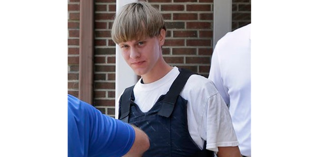 June 18: Charleston, S.C., shooting suspect Dylann Storm Roof is escorted from the Sheby Police Department  in Shelby, N.C.