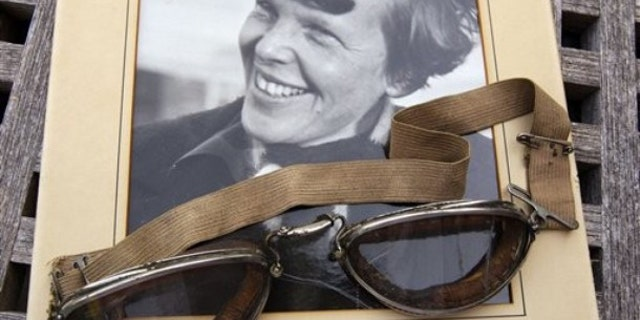 Sept. 9, 2011: An original, unpublished personal photo of Amelia Earhart dated 1937, along with goggles she was wearing during her first plane crash are seen at Clars Auction Gallery in Oakland, Calif. Another set of her goggles sold several years ago for more than $100,000.