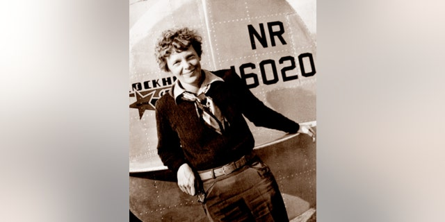 This May 20, 1937 photo, provided by The Paragon Agency, shows aviator Amelia Earhart at the tail of her Electra plane, taken by Albert Bresnik at Burbank Airport in Burbank, Calif.