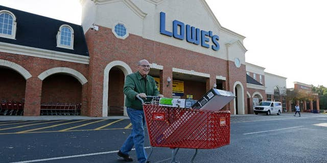 FILE - In this Nov. 18, 2014 file photo, a customer leaves a Lowe's home improvement store in Charlotte, N.C. Lowe's Companies Inc. reports quarterly financial results before the market opens Wednesday, May 20, 2015. (AP Photo/Chuck Burton, File)