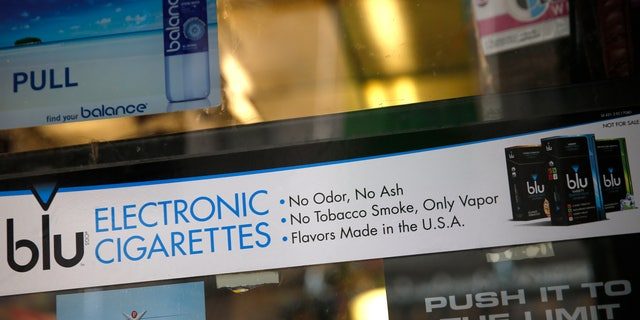 May 27, 2014: An advertisement for the e-cigarette brand blu is seen in the window of a store in New York.