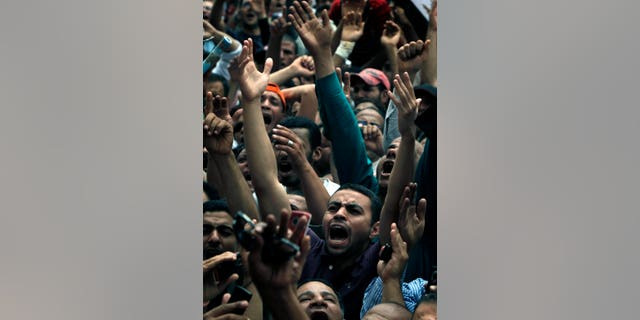 """Egyptian protesters chant slogans during a protest at Tahrir Square in Cairo, Egypt ,Friday, May 27, 2011. Thousands of protesters poured into downtown Cairo's Tahrir Square Friday for what they called a """"second revolution,"""" striking harsh tone against Egypt's military rulers, and say """"Egyptians' revolution is not over."""""""