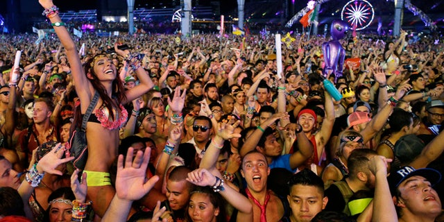 In this Saturday, June 21, 2014 file photo, carnival-goers dance to music by Krewella at the Electric Daisy Carnival in Las Vegas.聽