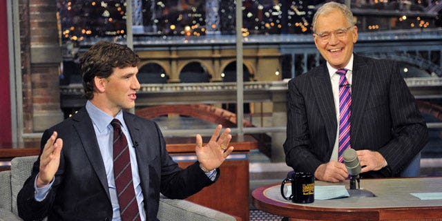 """Feb. 6: n this image released by CBS, Super Bowl MVP Eli Manning, of the New York Giants, left, is shown with host David Letterman on """"Late Show with David Letterman."""" (AP)"""