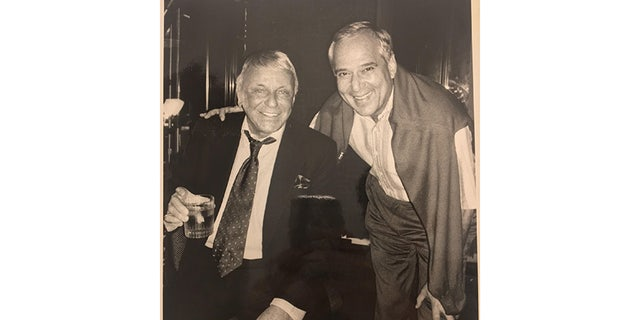 """Eliot Weisman with """"The Boss."""""""