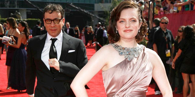 Elisabeth Moss and Fred Armisen at the 2009 Emmy Awards (REUTERS)