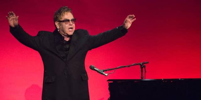 Elton John performs at 2014 AIDS Foundation Benefit.