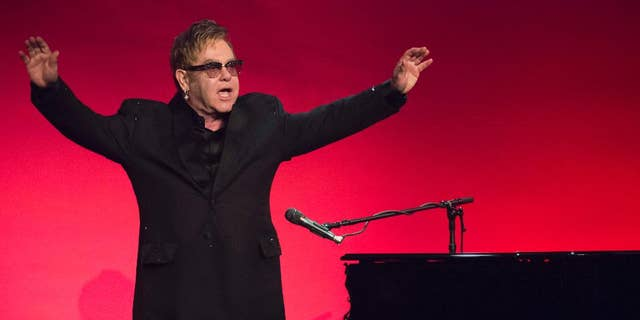 Elton John performs at 2014 AIDS Foundation Benefit.