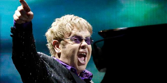 This June 30, 2012 file photo shows British pop star Elton John performing during the Euro 2012 soccer championship in Kiev, Ukraine.