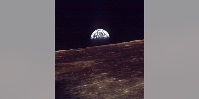 In this 1968 photo, the Earth rises over the horizon of the moon during the Apollo 8 mission.