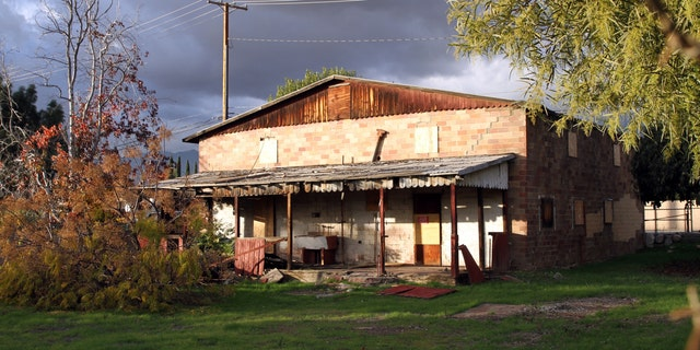 This image provided by Rick Ing and released by The National Trust for Historic Preservation, shows the rear of the Chinatown House in Rancho Cucamonga, Calif. The house is one of the last remaining connections to the history of Chinese Americans who helped build modern-day Rancho Cucamonga, leading to it being placed on the trusts 2013 list of 11 Most Endangered Historic Place. It once served as a general store and residence for about 50 Chinese American laborers. (AP Photo/Rick Ing, The National Trust for Historic Preservation)