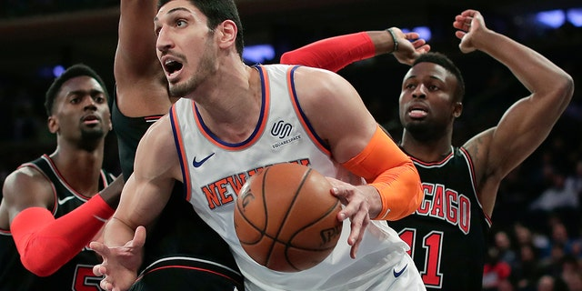 FILE - In this March 19, 2018, file photo, New York Knicks center Enes Kanter (00) drives to the basket against the Chicago Bulls during the first quarter of an NBA basketball game in New York. Kanter informed the Knicks on Friday, June 29, 2018, that he was opting into his contract for next season, rather than becoming a free agent. (AP Photo/Julie Jacobson, File)