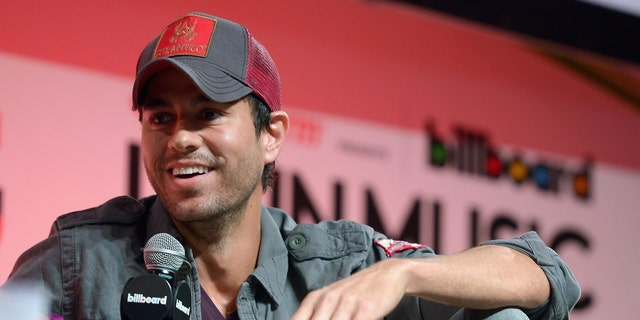 MIAMI, FL - APRIL 23:  Enrique Iglesias announces Fall Tour with Pitbull and J Balvin As Support at JW Marriott Marquis on April 23, 2014 in Miami, Florida.  (Photo by Gustavo Caballero/Getty Images for AEG Live)