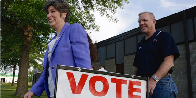 June 3, 2014: GOP Senate candidate Joni Ernst and husband Gail, right, leave a polling station in Red Oak, Iowa.