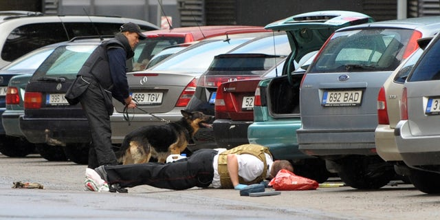 August 11:Estonian police officers check the area for explosives near the Defense Ministry building in Tallinn, Estonia. A gunman opened fire inside the building as he tried to take hostages but he apparently was shot and killed by police. The attacker entered the ministry at midday, threw a smoke bomb, fired shots and tried to kidnap two employees.