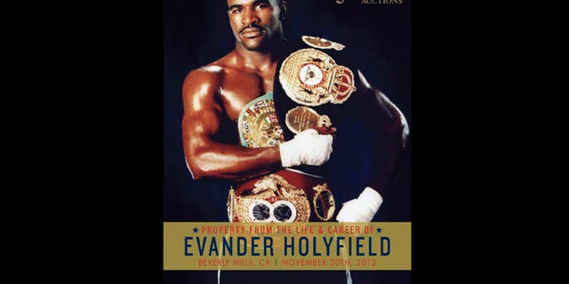 This undated publicity photo released by Julien's Auctions shows the cover of the catalogue for an upcoming Evander Holyfield auction on Nov. 30, 2012, in Beverly Hills, Calif.