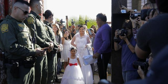 "November 18, 2017: Evelia Reyes married a U.S. citizen banned from Mexico during the ""Doors of Hope"" event. The groom has been revealed as a convicted drug smuggler, leaving border patrol agents furious for providing security for ""a cartel wedding."""