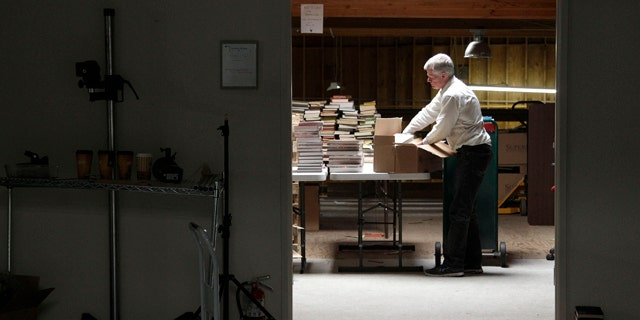 July 21, 2011: Mark, who did not give his last name, unpacks boxes of books at the Internet Archive's Physical Archive warehouse in Richmond, Calif. Saving a copy of every Web page ever posted sounds like an ambitious life's work, but Brewster Khale has decided digital isn't enough.