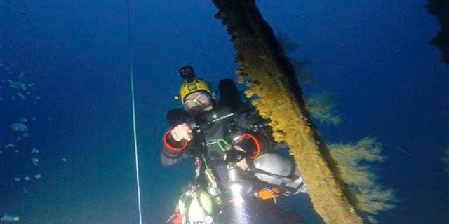 A diver investigates a shipwreck in this file photo.
