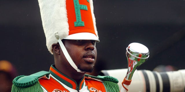 Nov. 19, 2011:  In this file photo, Robert Champion, a drum major in Florida A&M University's Marching 100 band, performs during halftime of a football game in Orlando, Fla.
