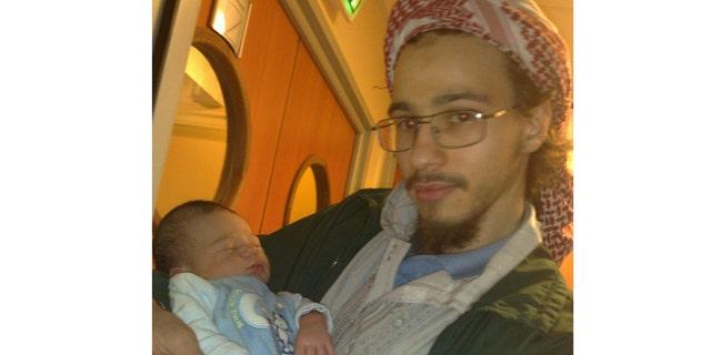 Farid Benyettou holding his nephew.