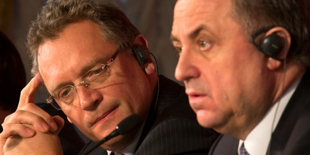 FILE - In this Feb. 16, 2015, file photo, FIFA Secretary General Jerome Valcke, left, and Russian Sports Minister Vitaly Mutko attend a news conference in St. Petersburg, Russia. (AP Photo/Dmitry Lovetsky, File)