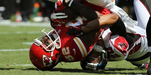 Sept. 8, 2012: Kansas City Chiefs wide receiver Dwayne Bowe (82) is tackled by Atlanta Falcons cornerback Brent Grimes (20) during the first half of an NFL football game at Arrowhead Stadium in Kansas City, Mo.