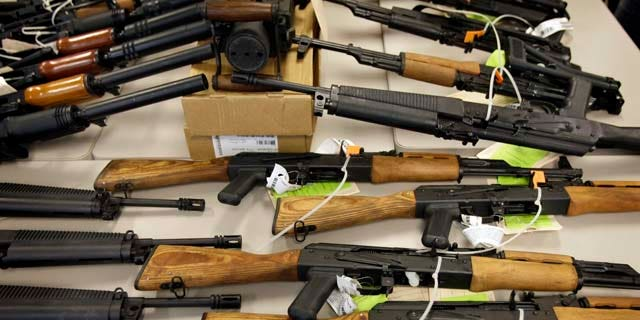 """This Tuesday, Jan. 25, 2011 picture shows part of a cache of seized weapons displayed at a news conference in Phoenix. The ATF is under fire over a Phoenix-based gun-trafficking investigation called """"Fast and Furious,"""" in which agents allowed hundreds of guns into the hands of straw purchasers in hopes of making a bigger case. Two of those weapons were found in December at the fatal shooting of U.S. Border Patrol agent Brian Terry, igniting a scandal that has resulted in a congressional investigation and review by the Justice Department's Office of Inspector General. (AP Photo/Matt York)"""