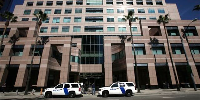 Feb. 17: Homeland Security police cars are shown parked outside the Long Beach, Calif., Federal Courthouse in Long Beach, Calif.