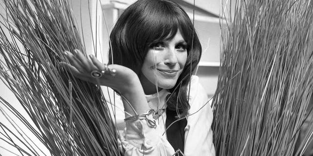 """In this Sept. 16, 1971, Fenella Fielding poses ahead of a one woman entertainment piece at the Withy Arts Festival in Somerset, England. British actress Fenella Fielding, the glamorous, velvet-voiced star of """"Carry On"""" comedies, has died at the age of 90."""