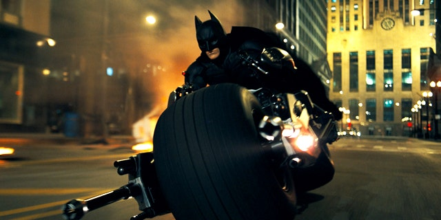 "Christian Bale rides a very custom chopper as Batman in a scene from ""The Dark Knight."""