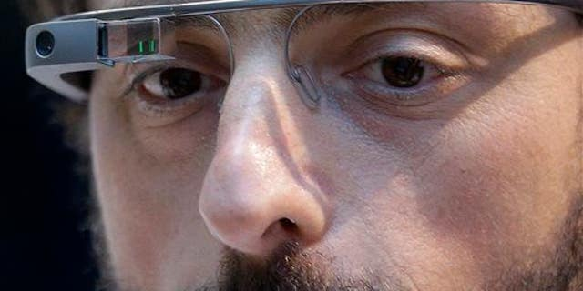 In this Feb. 20, 2013, file photo, Google co-founder Sergey Brin wears Google Glass in San Francisco.