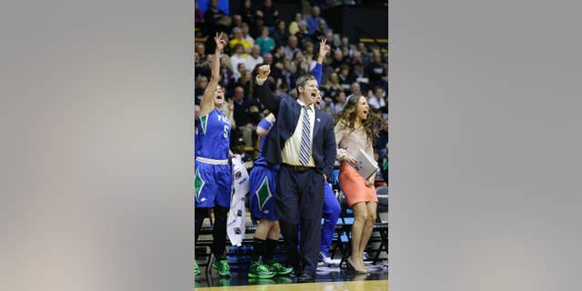 FILE - This March 22, 2014, file photo shows Florida Gulf Coast head coach Karl Smesko during the second half of a women's first round NCAA tournament college basketball game against Oklahoma State in West Lafayette, Ind. The Florida Gulf Coast coach with the tiny office has very quietly built a winning machine. (AP Photo/Michael Conroy, File)