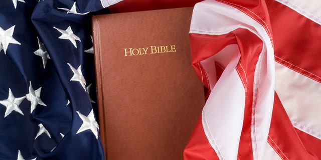 Holy bible in US flag. Close up.